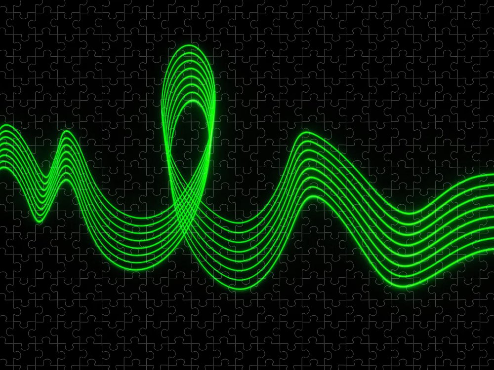 Laser Puzzle featuring the photograph Green Abstract Coloured Lights Trails by John Rensten