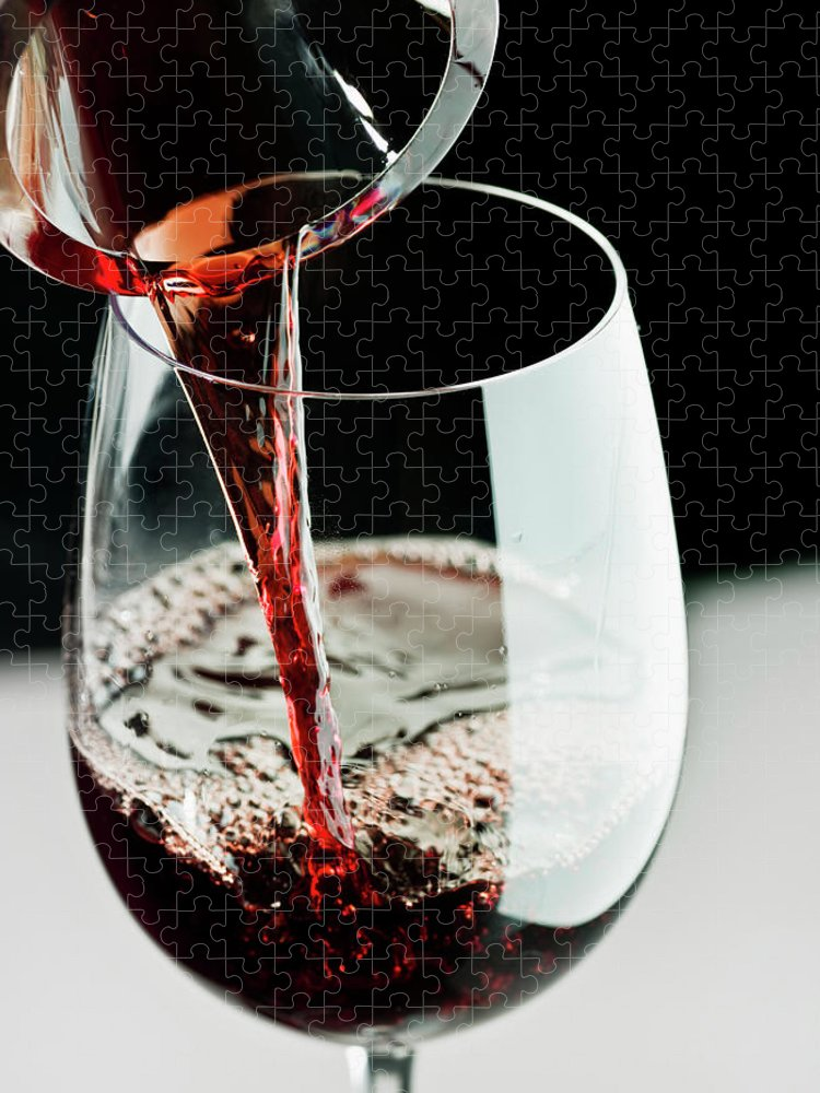 Alcohol Puzzle featuring the photograph Red Wine Being Poured In A Glass by Juanmonino