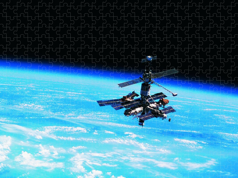 Alertness Puzzle featuring the photograph A Space Station Orbiting Above Earth by Stockbyte