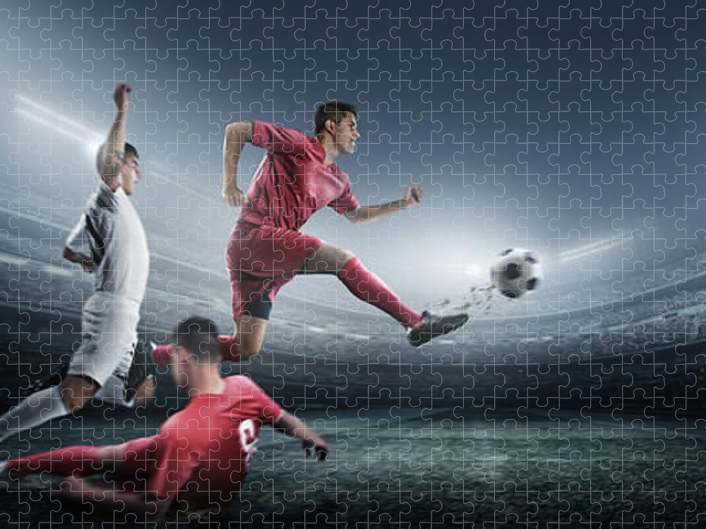 Soccer Uniform Puzzle featuring the photograph Soccer Player Kicking Ball In Stadium by Dmytro Aksonov