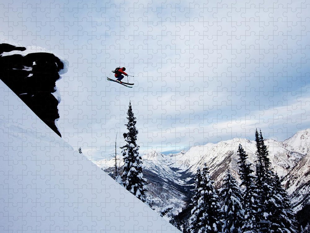 Skiing Puzzle featuring the photograph A Athletic Skier Jumping Off A Cliff In by Patrick Orton