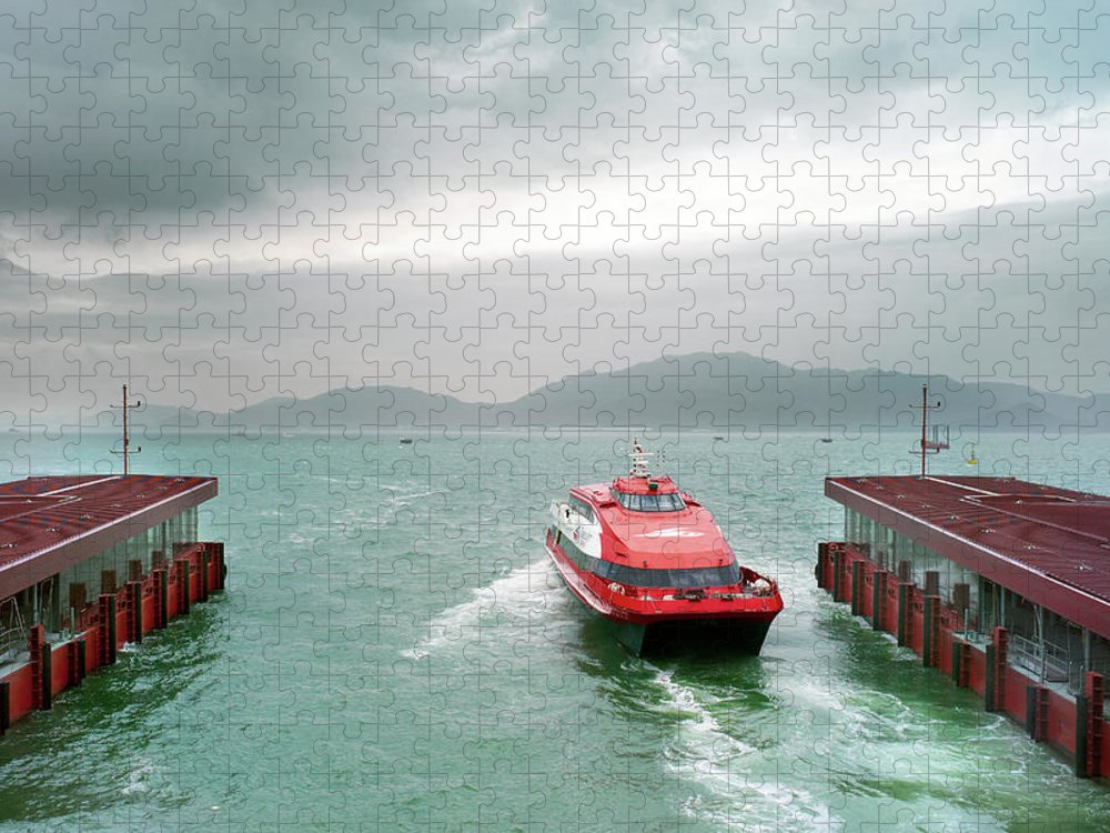 Macao Puzzle featuring the photograph A Catamaran Ferry Docks At A Port by Xpacifica