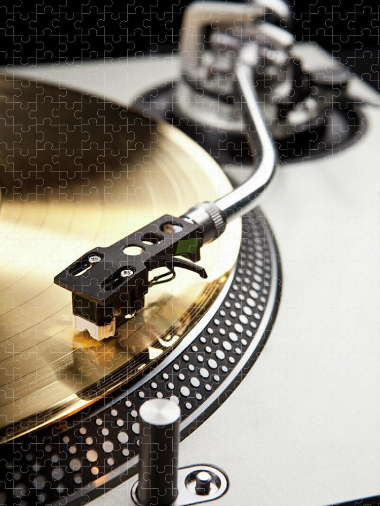 Music Puzzle featuring the photograph A Gold Record On A Turntable by Caspar Benson