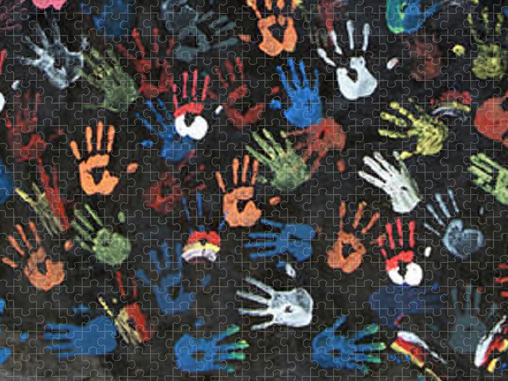 Child Puzzle featuring the photograph A Painting Of Colorful Handprints by Khananastasia