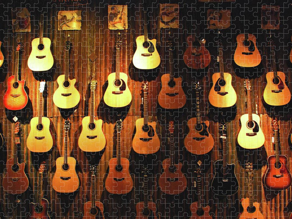 Hanging Puzzle featuring the photograph Acoustic Guitars On A Wall by Karas Cahill Photography