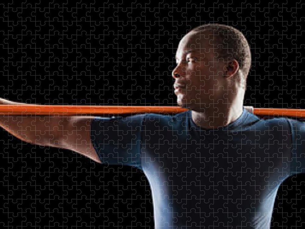 Young Men Puzzle featuring the photograph African American Man Holding Track And by Mike Kemp