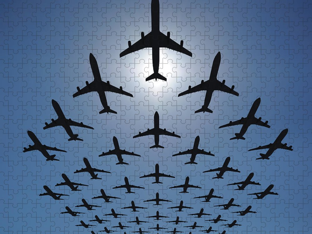 Expertise Puzzle featuring the photograph Airplane Silhouettes Fly In V Formation by Georgo