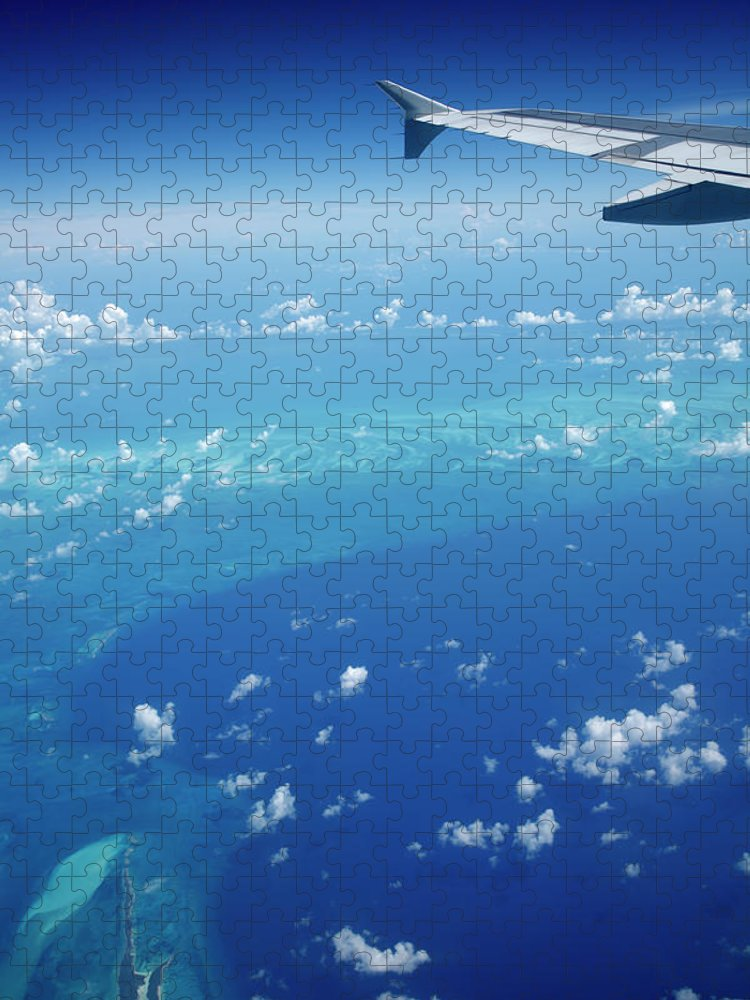 Scenics Puzzle featuring the photograph Airplane View Of The Caribbean by Cdwheatley