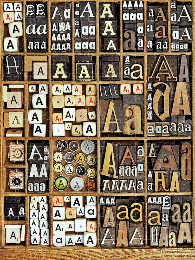 In A Row Puzzle featuring the photograph Alphabet by Daryl Benson