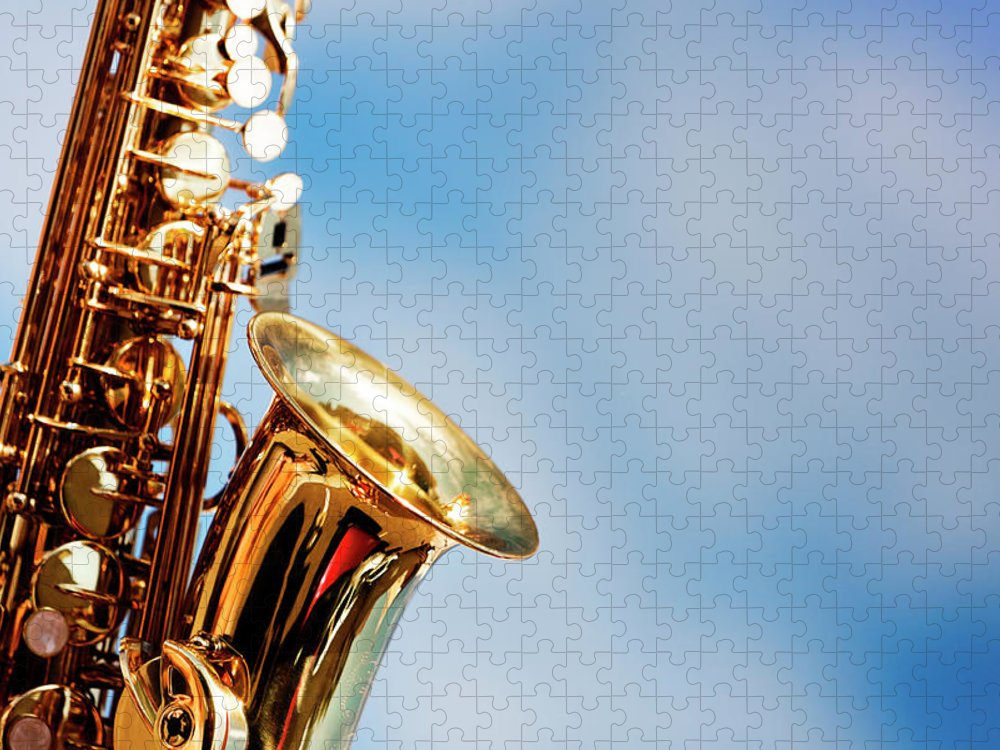 Rock Music Puzzle featuring the photograph Alto Sax Close Up Against Sky With by Rapideye
