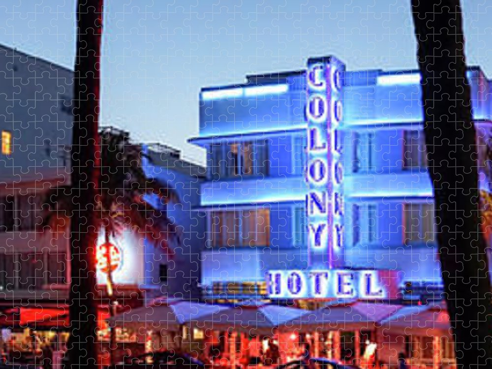 Panoramic Puzzle featuring the photograph Art Deco Hotels On Ocean Drive At Dusk by Buena Vista Images