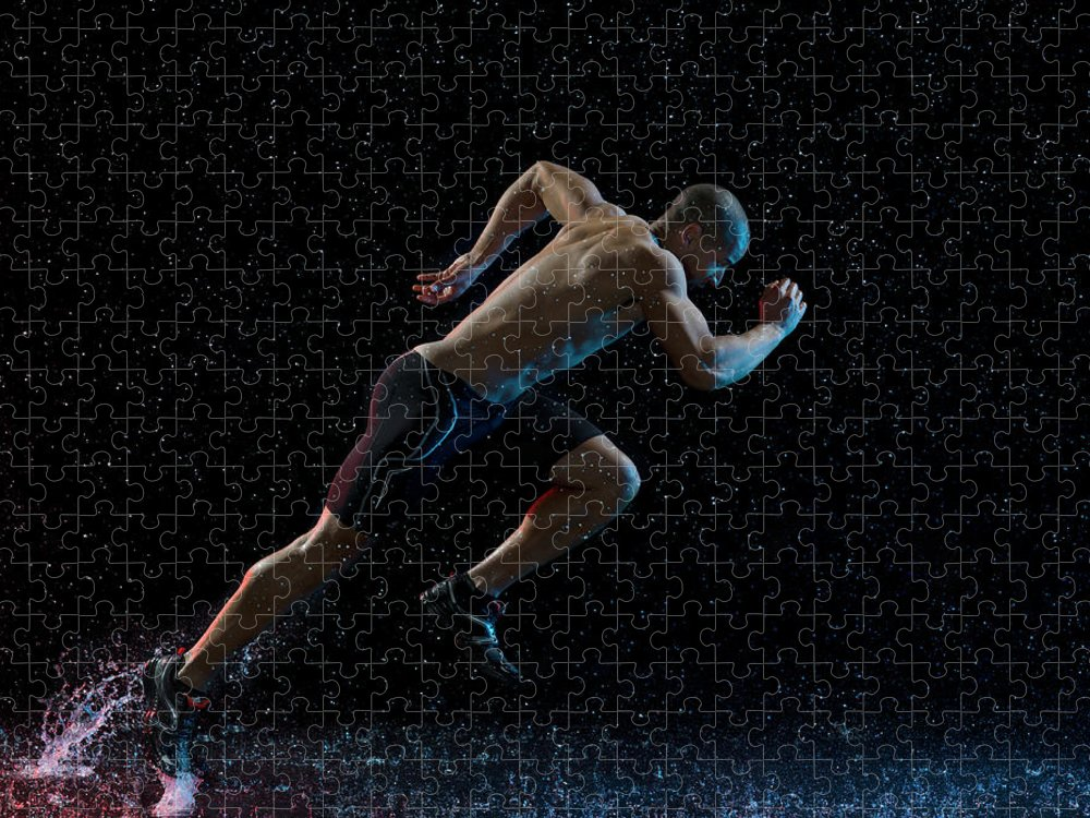 People Puzzle featuring the photograph Athlete Runner Running Through Rain by Jonathan Knowles