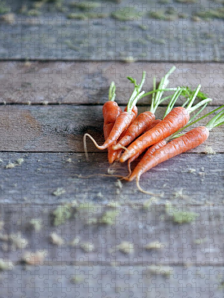 Outdoors Puzzle featuring the photograph Baby Carrots On Rustic Table by Devin Hart