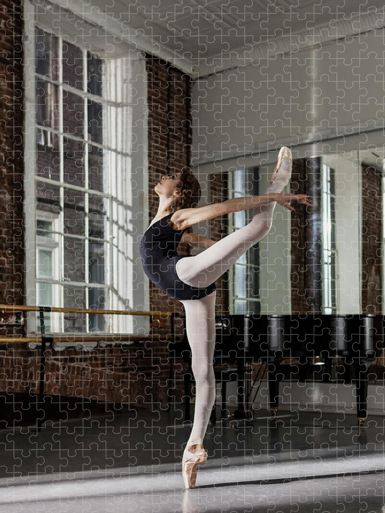 Ballet Dancer Puzzle featuring the photograph Ballerina Performing Attitude In Dance by Nisian Hughes