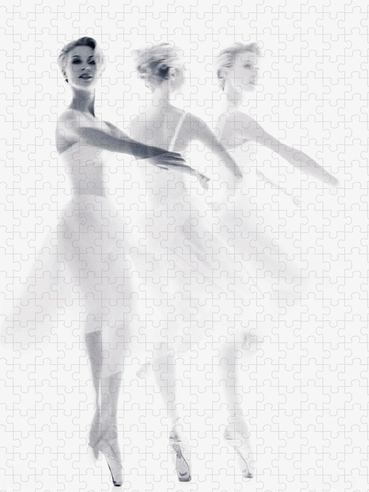 Ballet Dancer Puzzle featuring the photograph Ballet Dancer Pirouetting Multiple by Getty Images