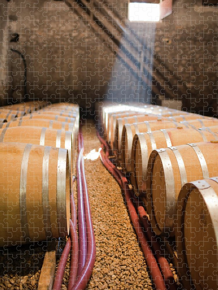Alcohol Puzzle featuring the photograph Barrels In Wine Cellar by Johner Images