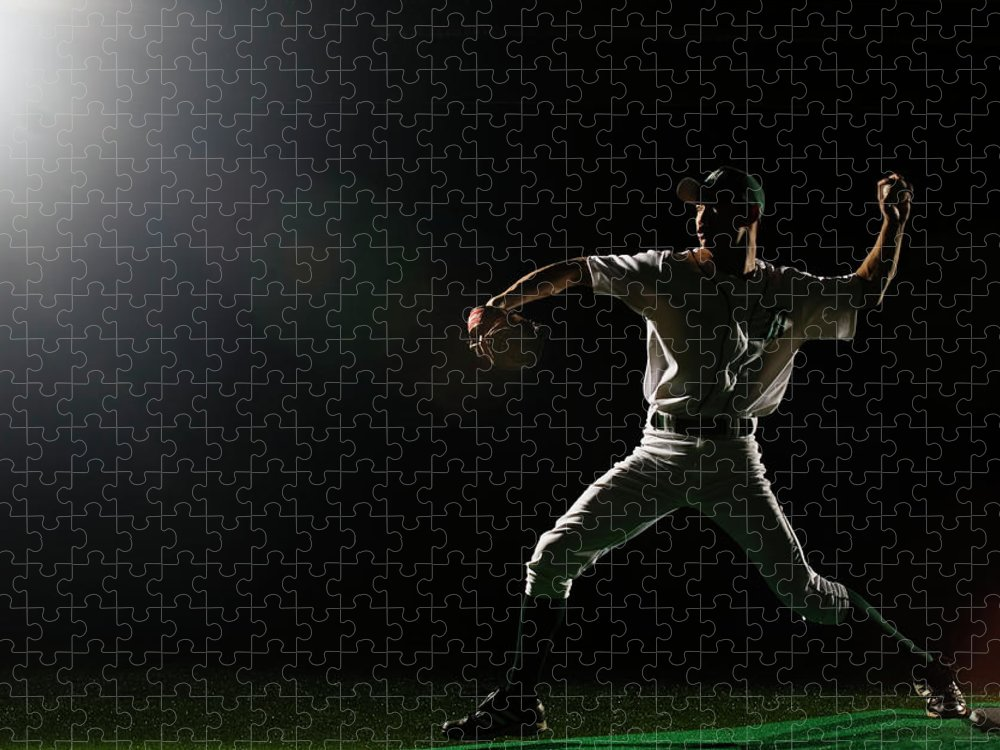 Human Arm Puzzle featuring the photograph Baseball Pitcher Releasing Ball by Pm Images