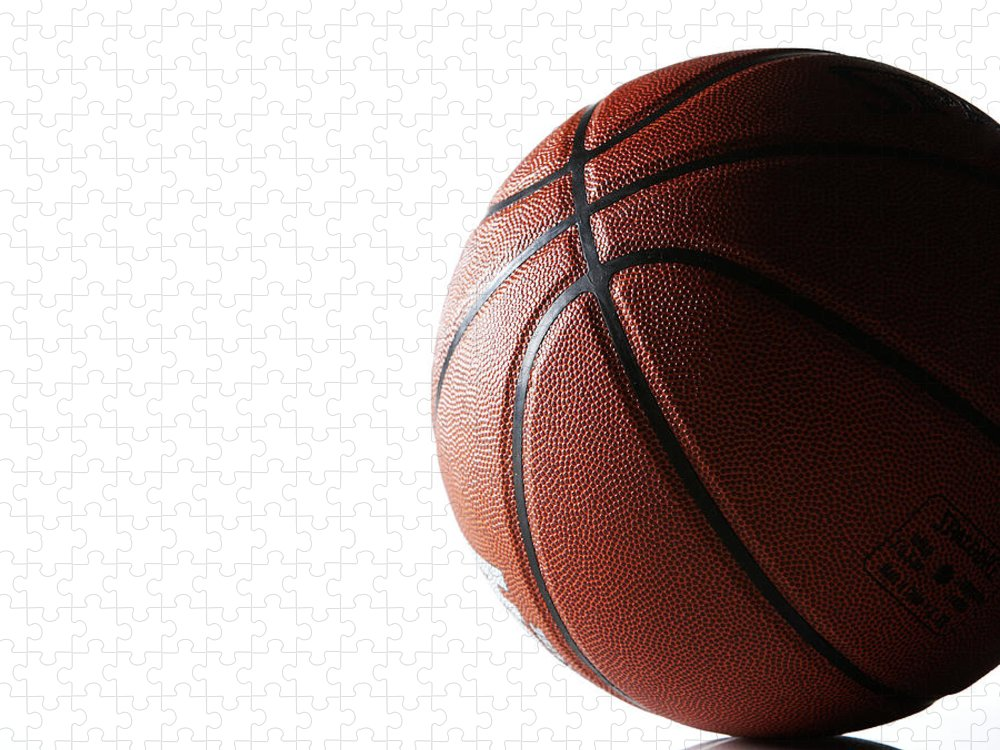 Recreational Pursuit Puzzle featuring the photograph Basketball On White Background by Thomas Northcut