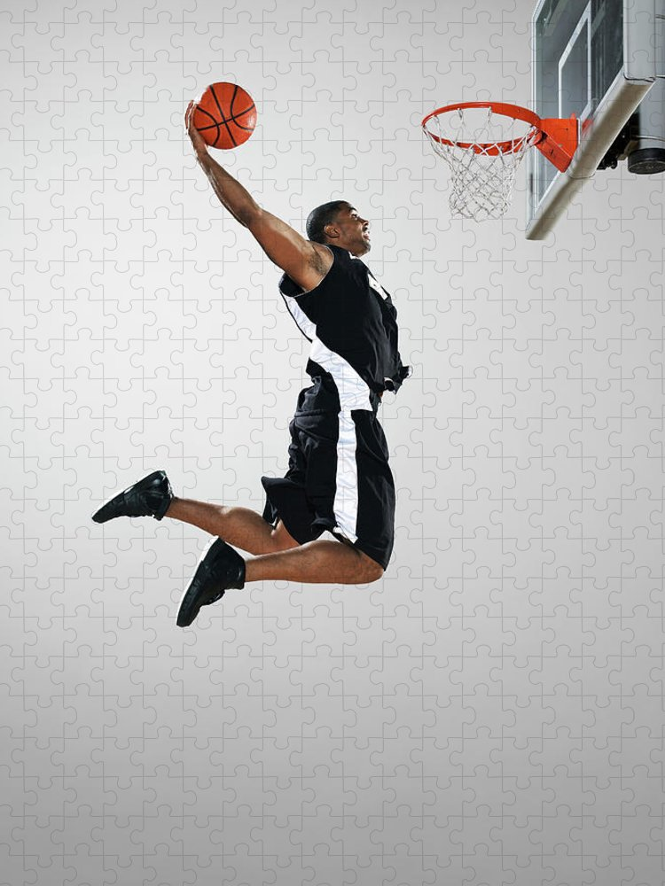 People Puzzle featuring the photograph Basketball Player Dunking Ball, Low by Blake Little