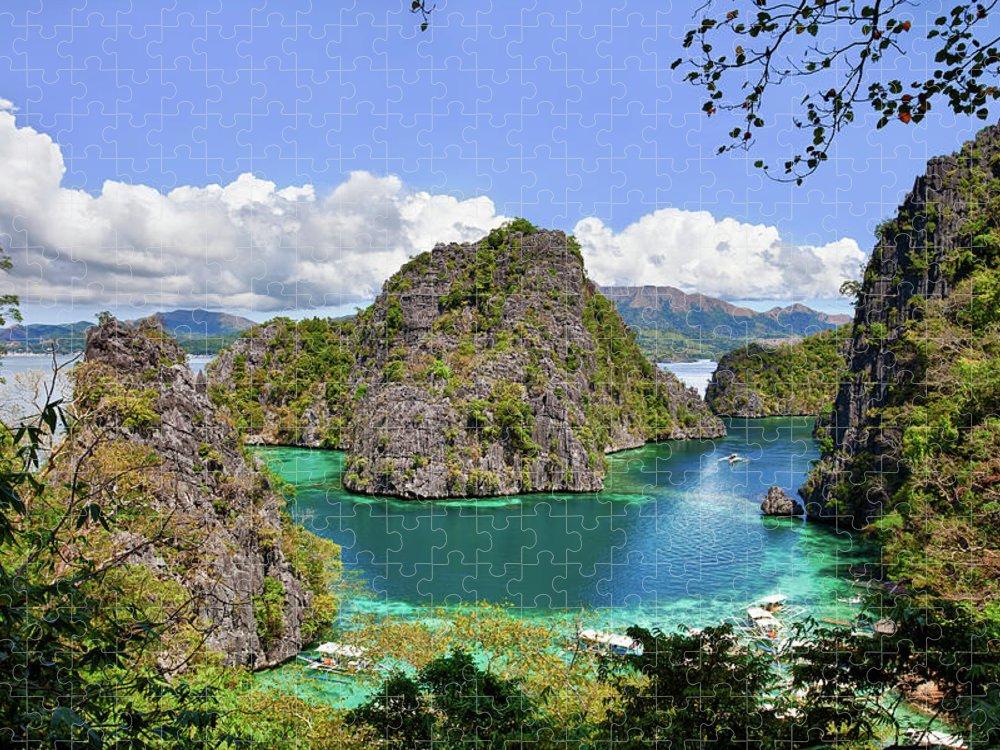 Scenics Puzzle featuring the photograph Beautiful Blue Lagoon At Kayangan Lake by Fototrav