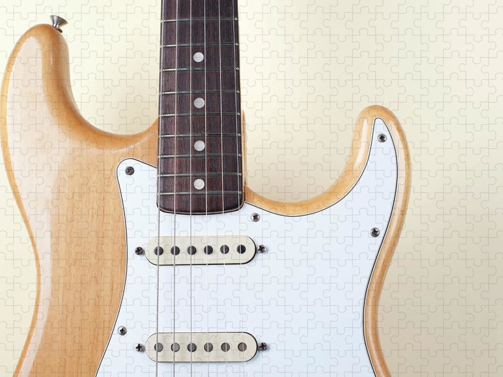 Rock Music Puzzle featuring the photograph Beige Wood Textured Electric Guitar by Neyya