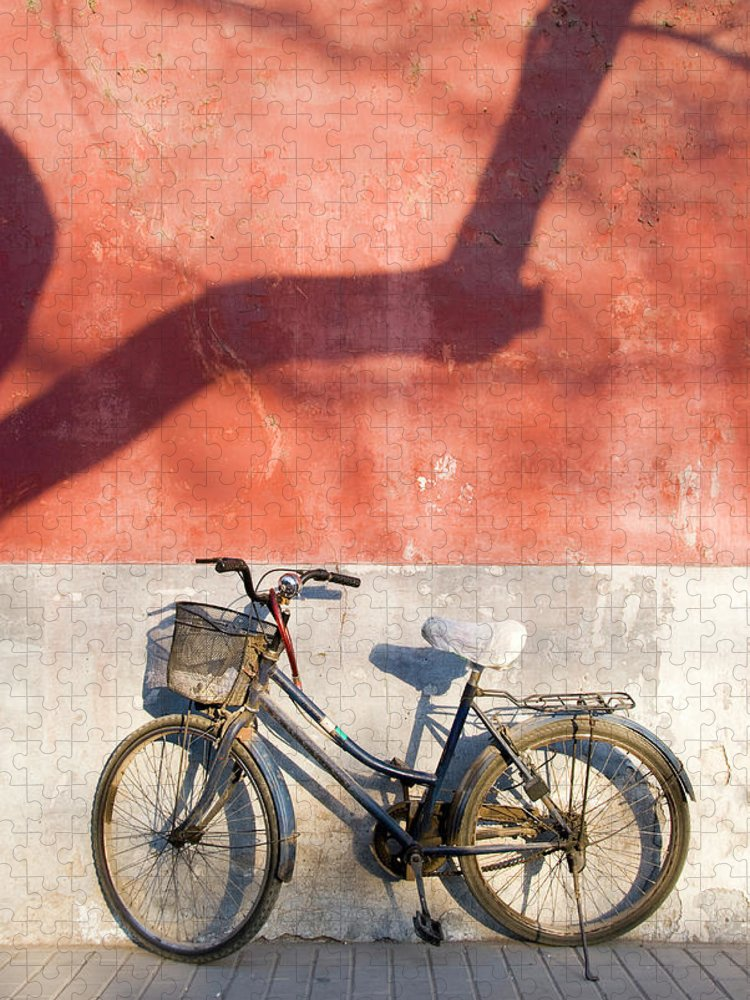 Chinese Culture Puzzle featuring the photograph Bicycle Against Red Wall by Frankvandenbergh