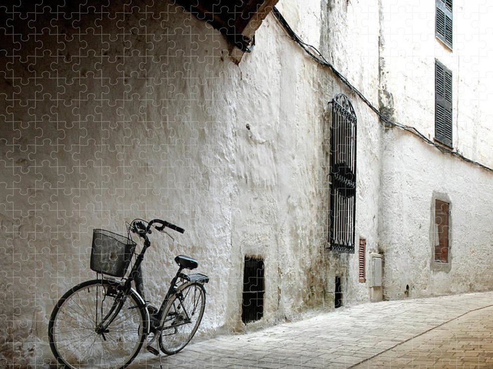 Tranquility Puzzle featuring the photograph Bicycle Leaning Wall by Antonio R. Ramos