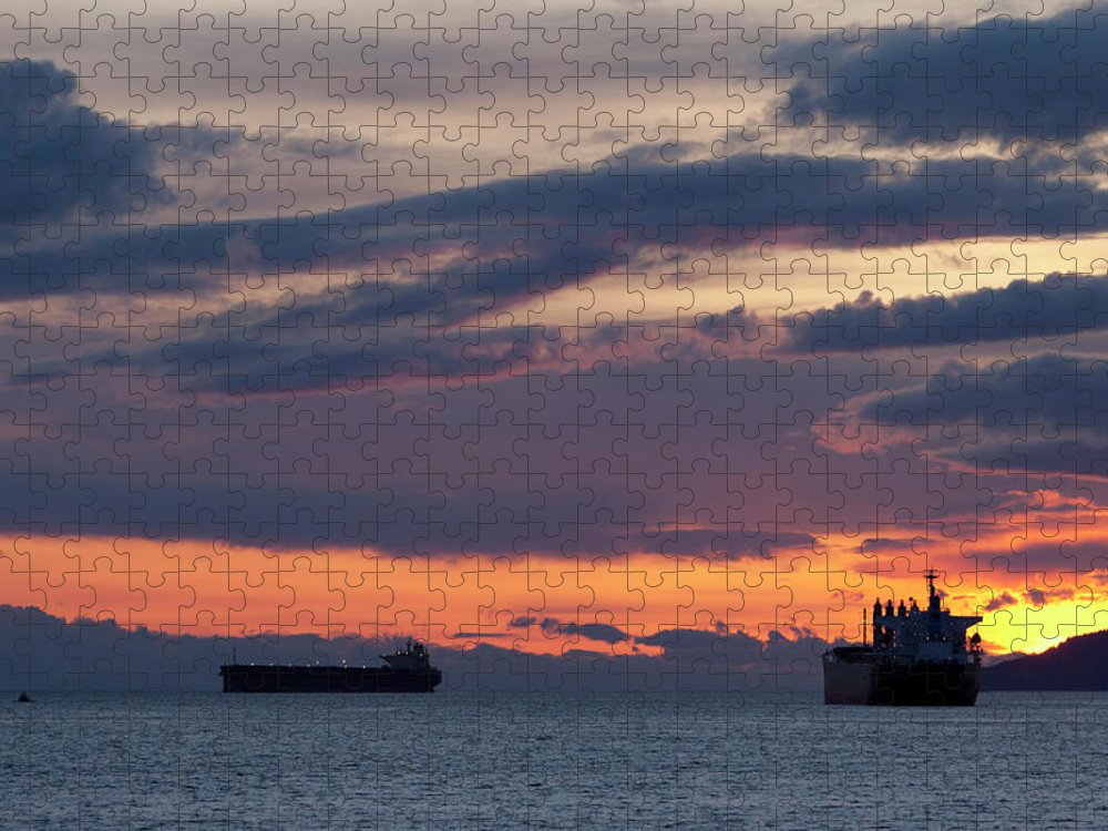 Scenics Puzzle featuring the photograph Big Boat Silhouettes by Visualcommunications