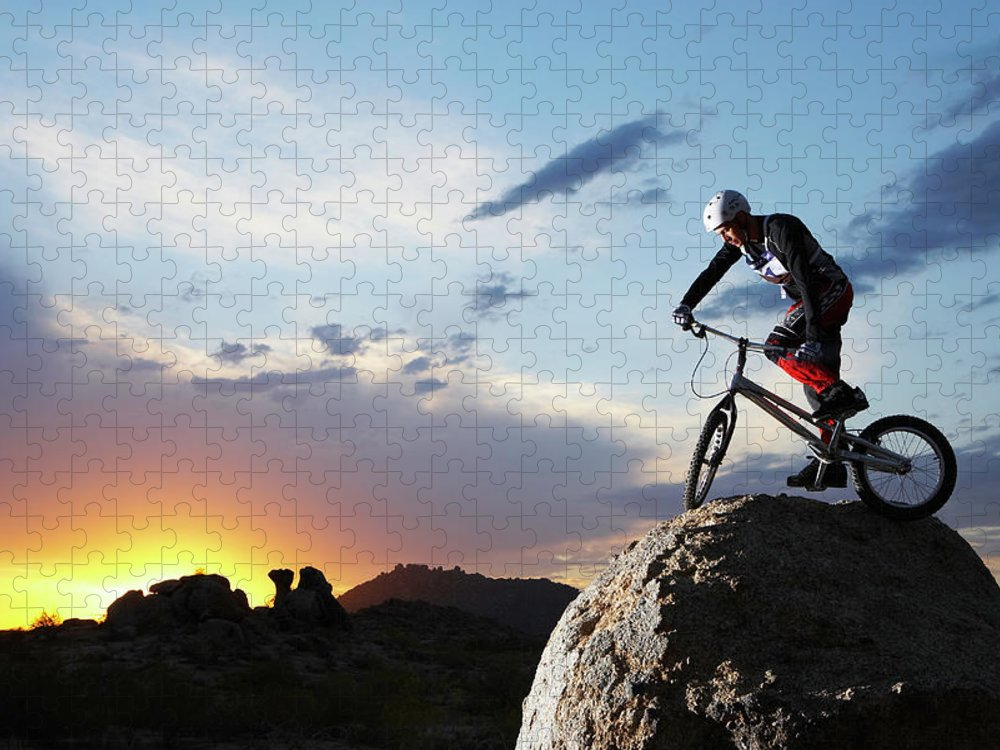Sports Helmet Puzzle featuring the photograph Bike Rider Balancing On Rock Boulder by Thomas Northcut