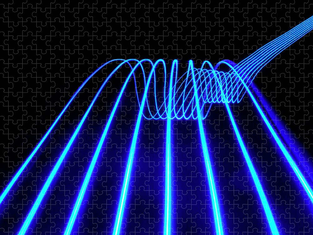 Laser Puzzle featuring the photograph Blue Abstract Coloured Lights Trails by John Rensten