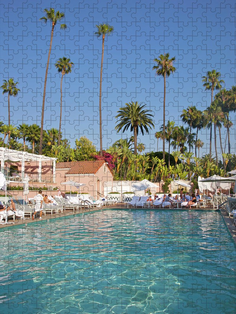 Tranquility Puzzle featuring the photograph Blue-bottomed Pool Beneath Palm Trees by Barry Winiker