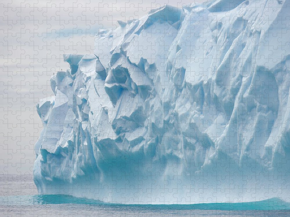Scenics Puzzle featuring the photograph Blue Iceberg Carved By Waves Floats In by Eastcott Momatiuk