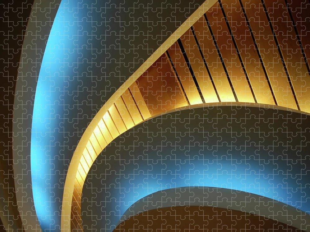 Curve Puzzle featuring the photograph Blue Swirl by Copyright Ralph Grunewald