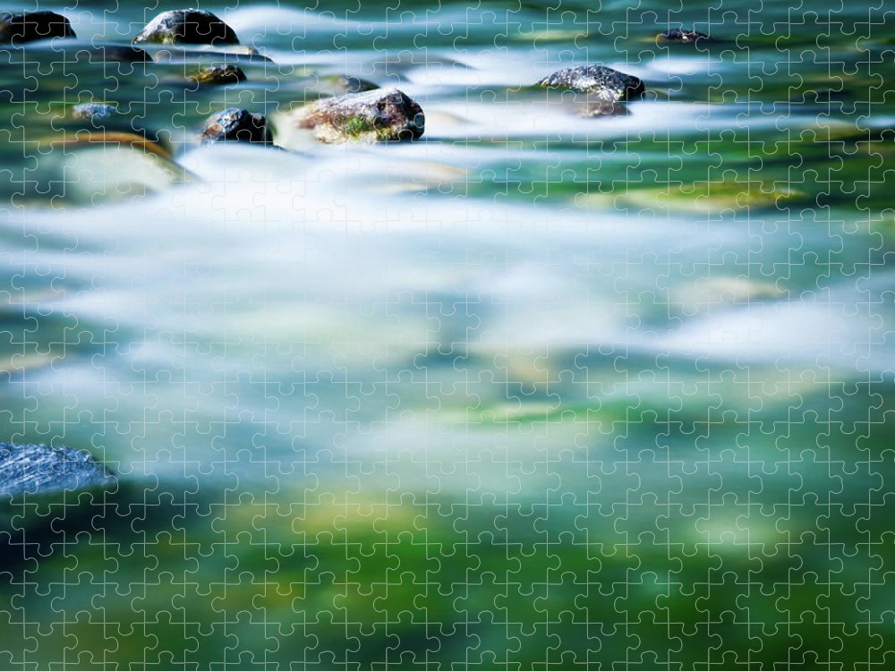 Scenics Puzzle featuring the photograph Blurred River by Assalve