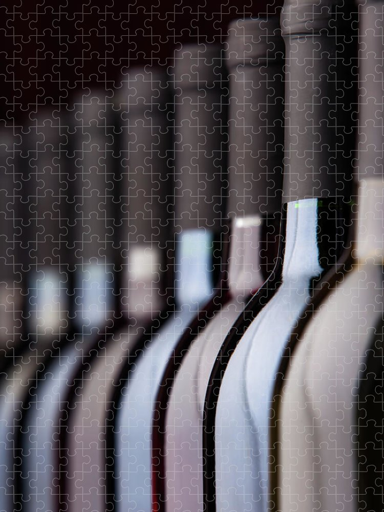 Alcohol Puzzle featuring the photograph Bottles Of Wine In A Row by Halbergman