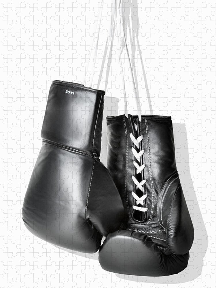Hanging Puzzle featuring the photograph Boxing Gloves Hanging Against White by Burazin