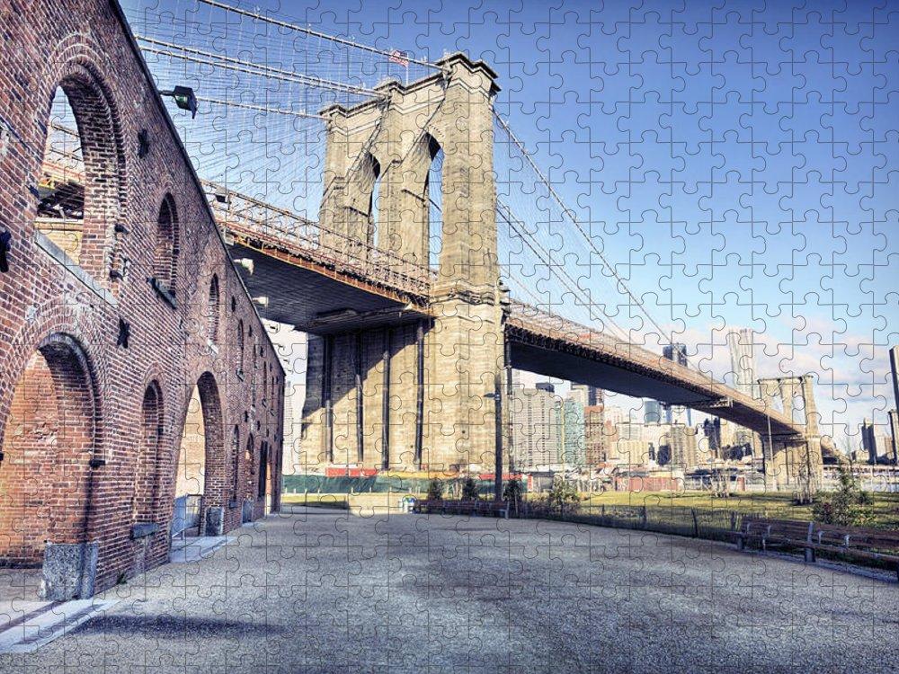 Lower Manhattan Puzzle featuring the photograph Brooklyn Bridge From Down Under by By Gene Krasko