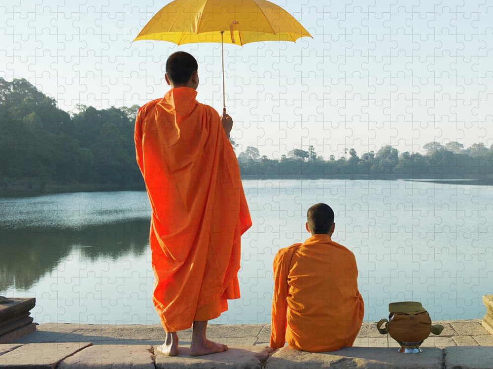 Young Men Puzzle featuring the photograph Buddhist Monks Standing In Front Of by Martin Puddy