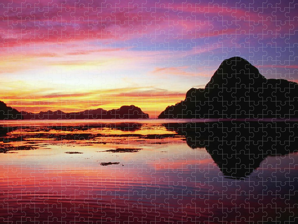 Scenics Puzzle featuring the photograph Cadlao Island Silhouetted At Sunset by Dallas Stribley