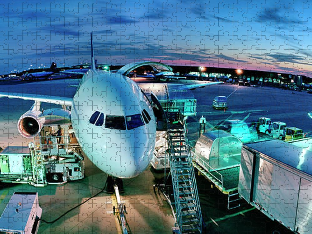 Freight Transportation Puzzle featuring the photograph Cargo Plane Being Loaded At Night by Greg Pease