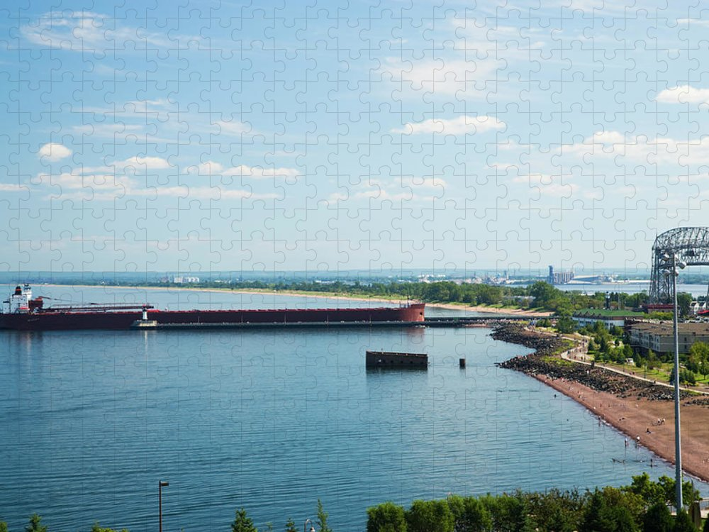 Water's Edge Puzzle featuring the photograph Cargo Ship Entering Harbor In Duluth by Jimkruger