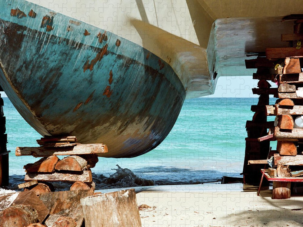 Freight Transportation Puzzle featuring the photograph Catamaran Repair On Beach In Jamaica by Joseph X. Burke Analog Photography