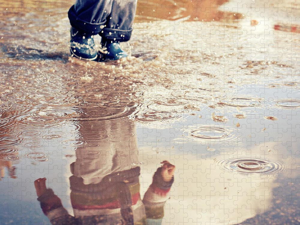 Toddler Puzzle featuring the photograph Child In A Puddle by Vpopovic