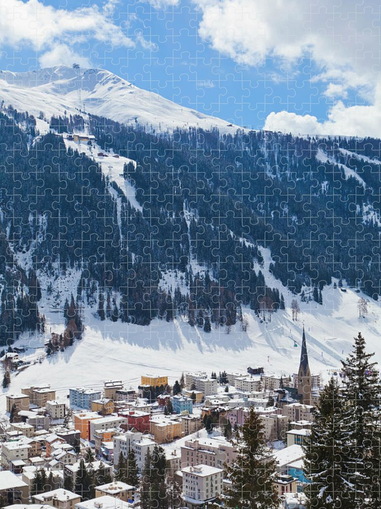 Snow Puzzle featuring the photograph Cityscape Of Davos, Grisons, Switzerland by Werner Dieterich