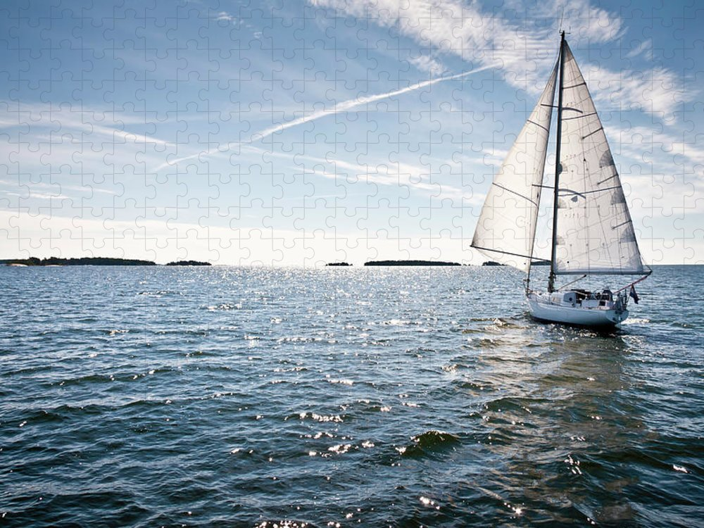 Recreational Pursuit Puzzle featuring the photograph Classic Yacht Sailing Away Against Blue by Jaap-willem