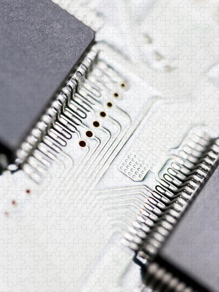 Electrical Component Puzzle featuring the photograph Close-up Of A Circuit Board by Nicholas Rigg