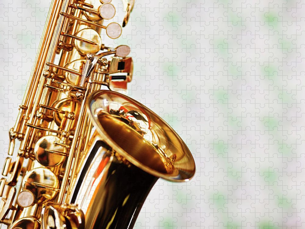 Rock Music Puzzle featuring the photograph Close Up Of Saxophone Against Faded by Rapideye
