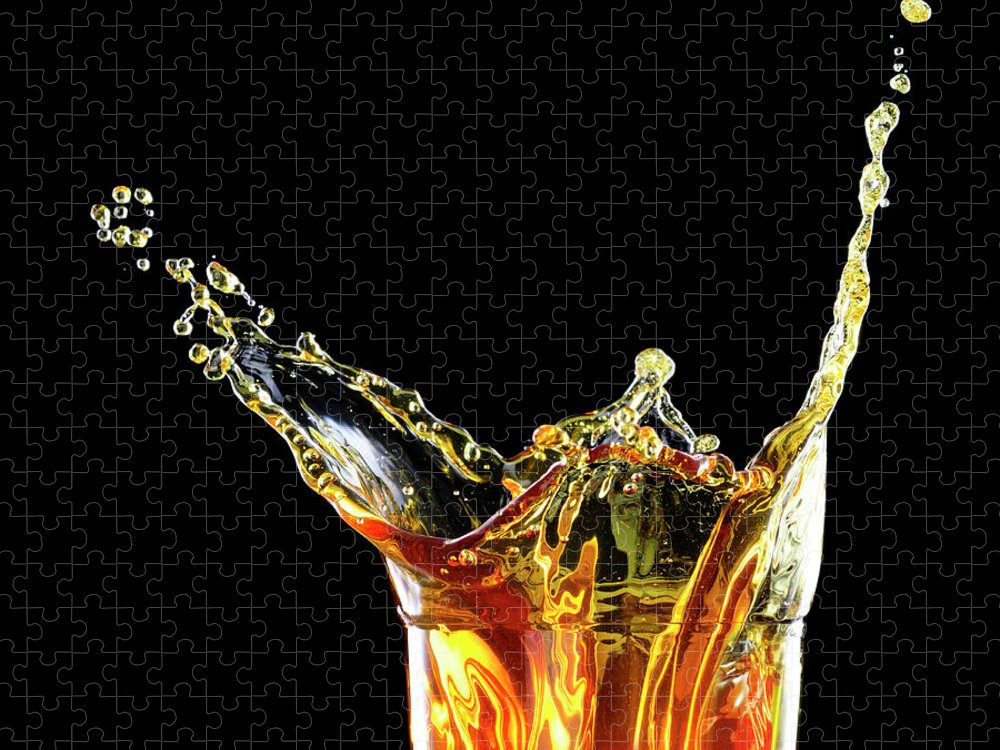 Alcohol Puzzle featuring the photograph Cocktail With Big Splash In A Tumbler by Chris Stein
