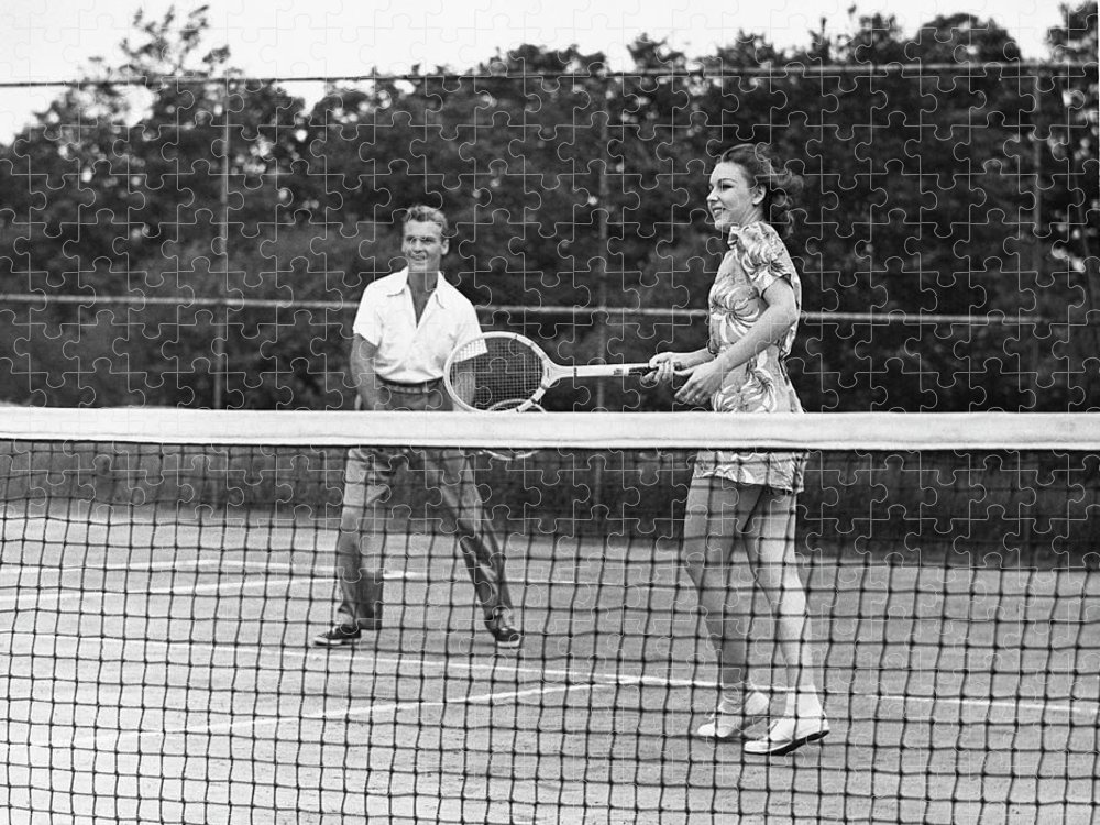 Heterosexual Couple Puzzle featuring the photograph Couple Playing Tennis by George Marks