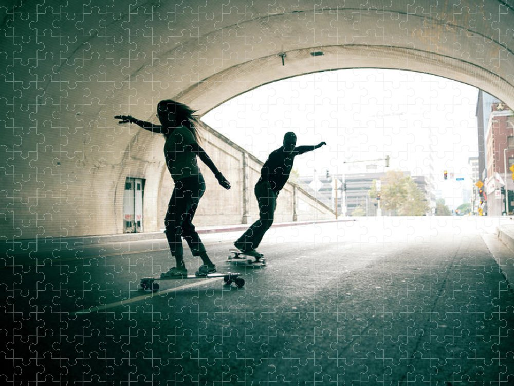 Mature Adult Puzzle featuring the photograph Couple Skateboarding Through Tunnel by Ian Logan